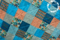 Completed quilt top with diagonal stitching